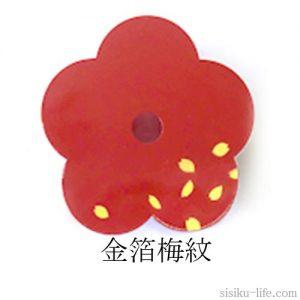 金箔で花びらを描いた梅紋方の鉄製壁掛け一輪挿し